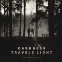 DARKNESS TRAVELS LIGHT